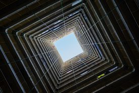 Hong Kong. View from directly below an old apartment building in Kowloon.