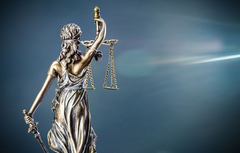 Low Angle View Of Lady Justice Against Sky