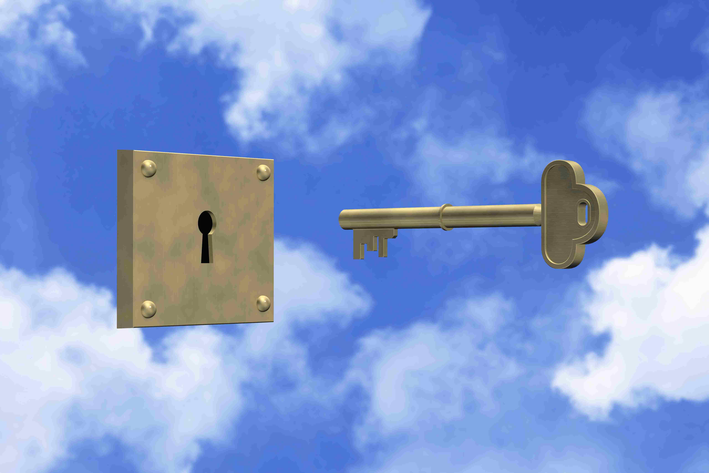 Key and keyhole against sky
