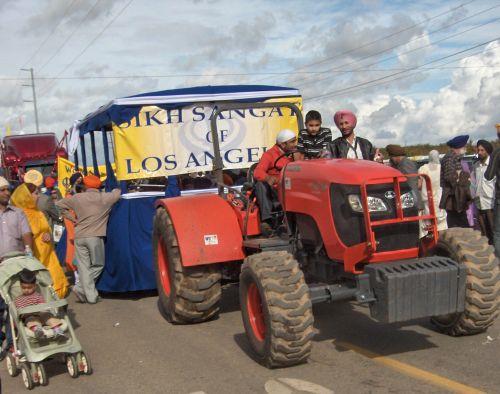 Stroller Alongside Tractor Trolley Pulling Float in Yuba City Sikh Parade