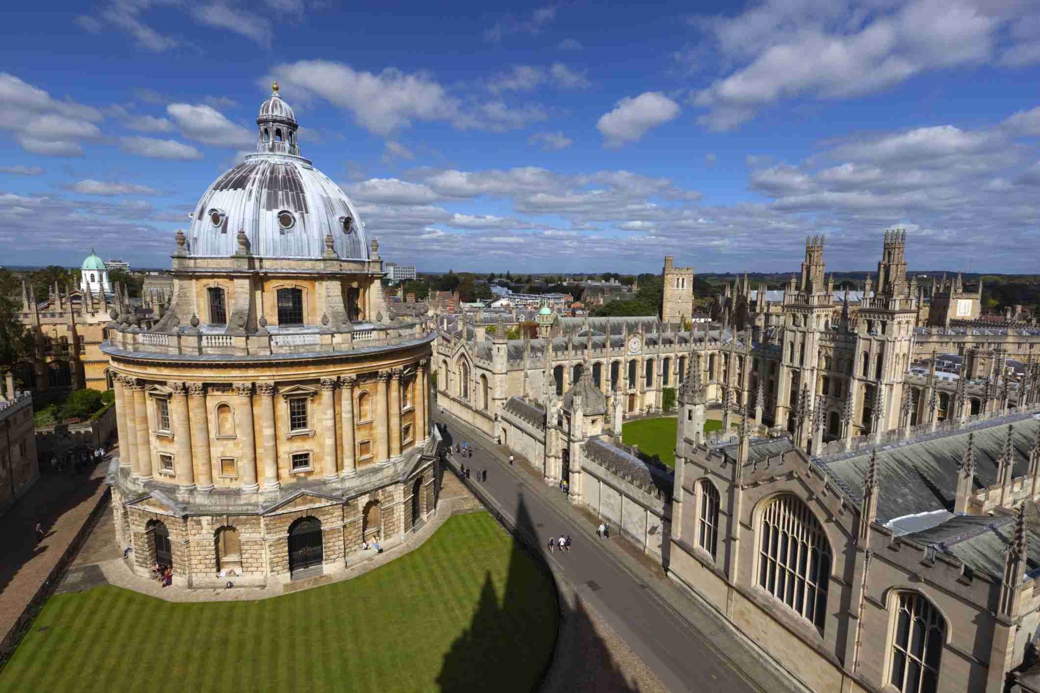 Radcliffe Camera and All Souls College in Oxford, England against a blue sky