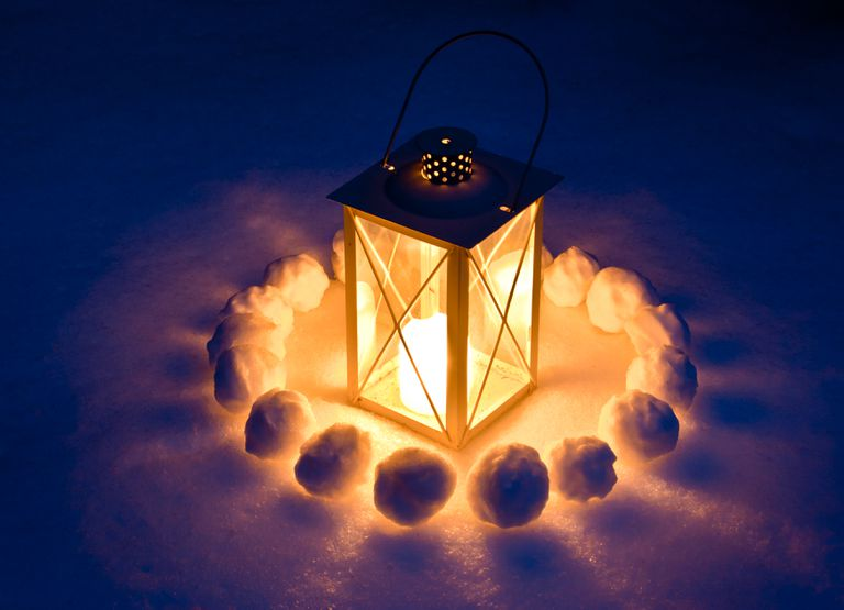 Candle Lantern In Snow