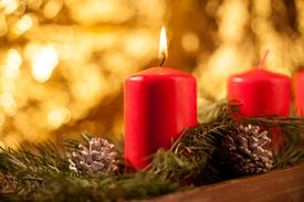 Close-Up Of Christmas Decorations With Candles