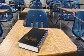 Holy Bible Lying on a Parochial School Desk