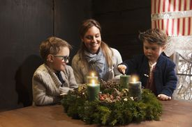 Family lightning candles on a Advent wreath