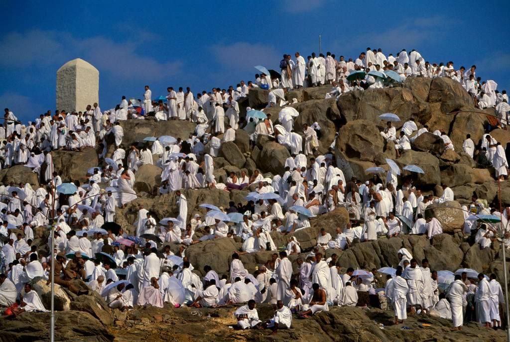 Pilgrims climb Jabal Al-Rahma (the mountain of mercy) in the plain of Arafat, southeast of the holy city of Mecca, during the hajj
