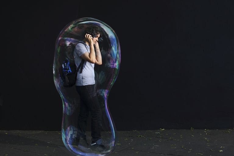 Young man enclosed in a bubble