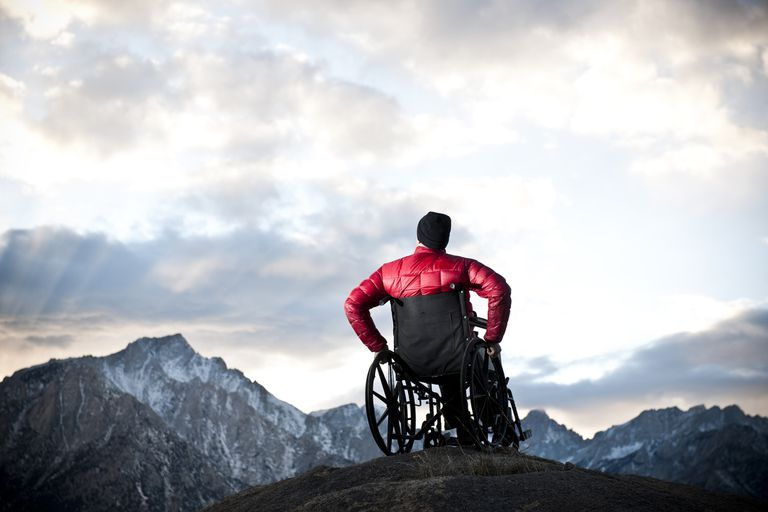 A man in a wheelchair looking to the heavens