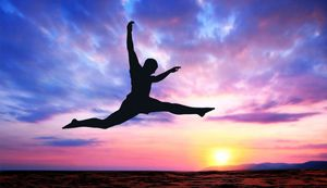 energetic leaping man in sunset