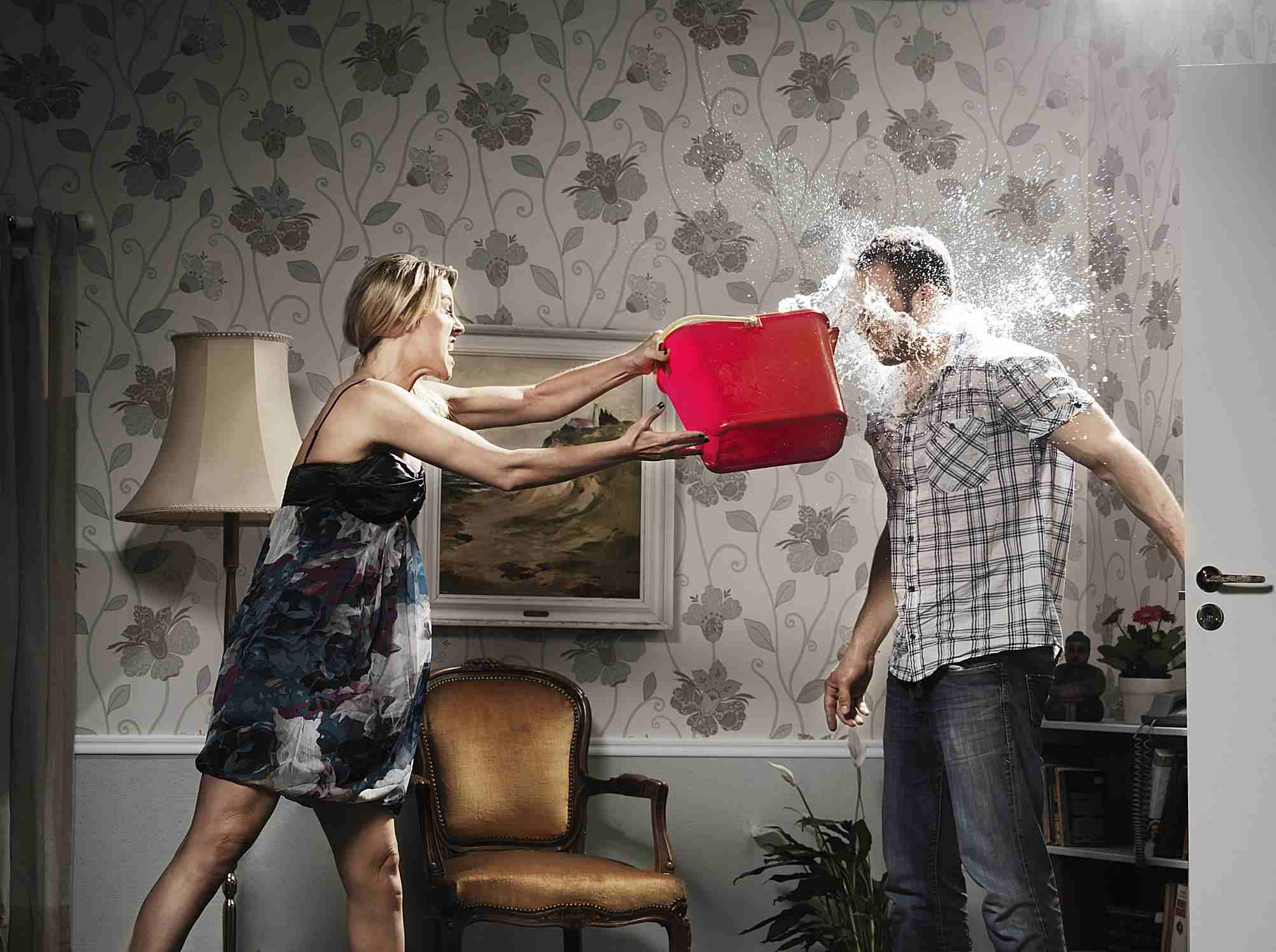 Girl Throwing Water in Mans Face