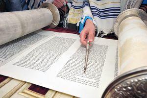 Boy reading Torah for his Bar Mitzvah