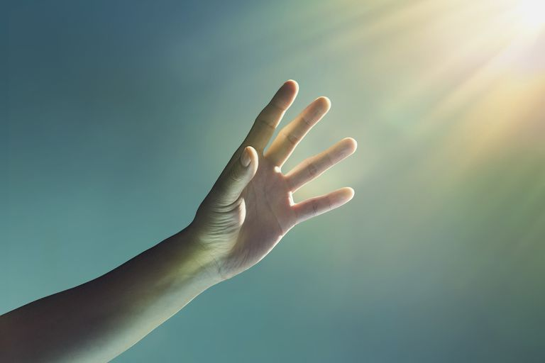 Hand reaching up toward the light