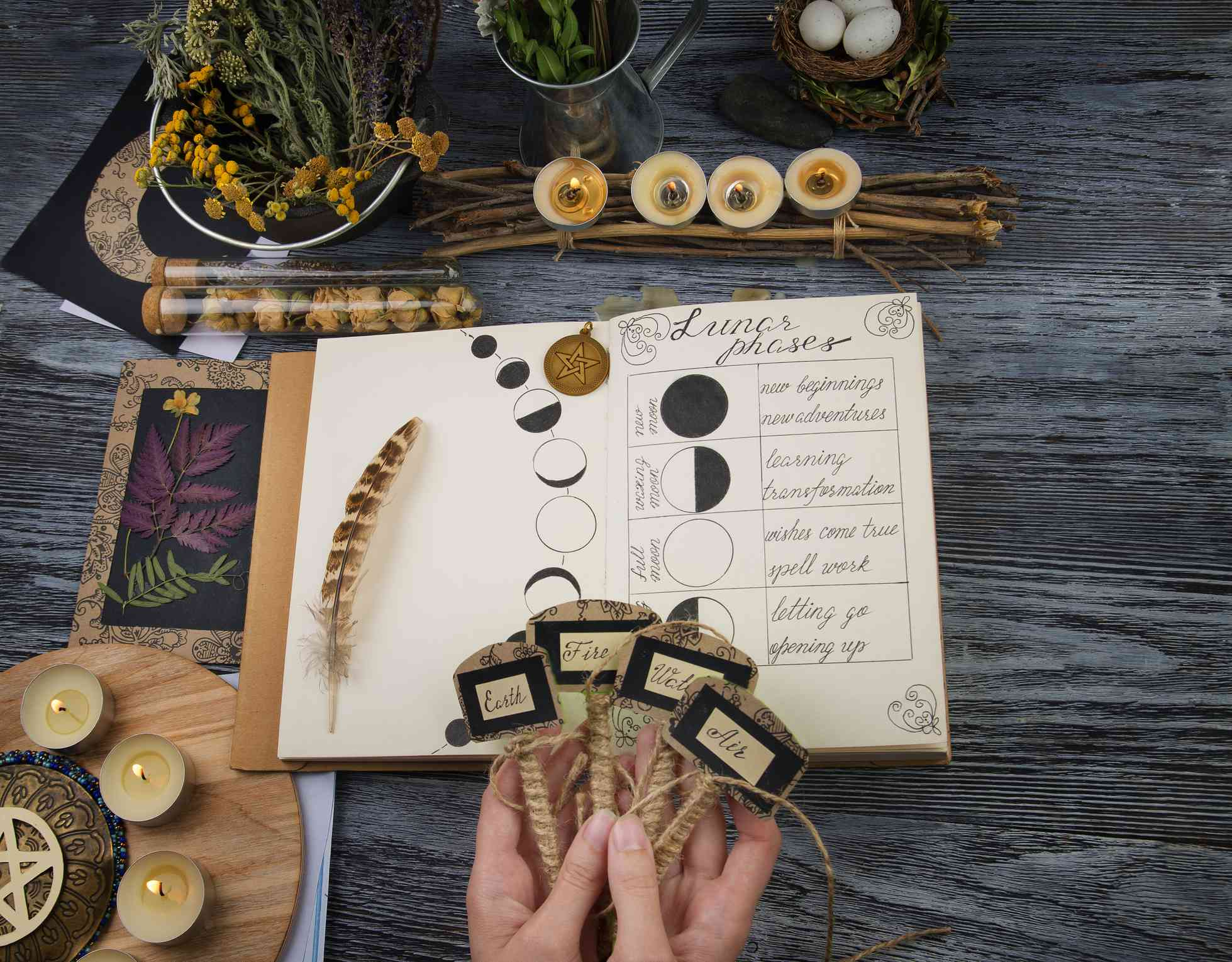 Witch preparing ingredients for moon ritual