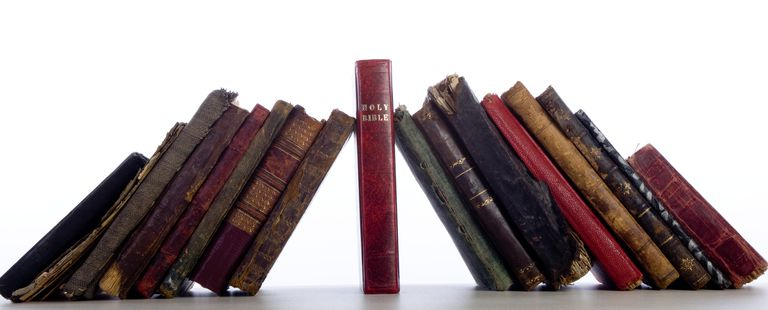 Group Of Antique Old Books Leaning On Bible.