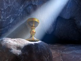 Holy Grail (chalice) in a cave, lit by a stream of sunshine from above