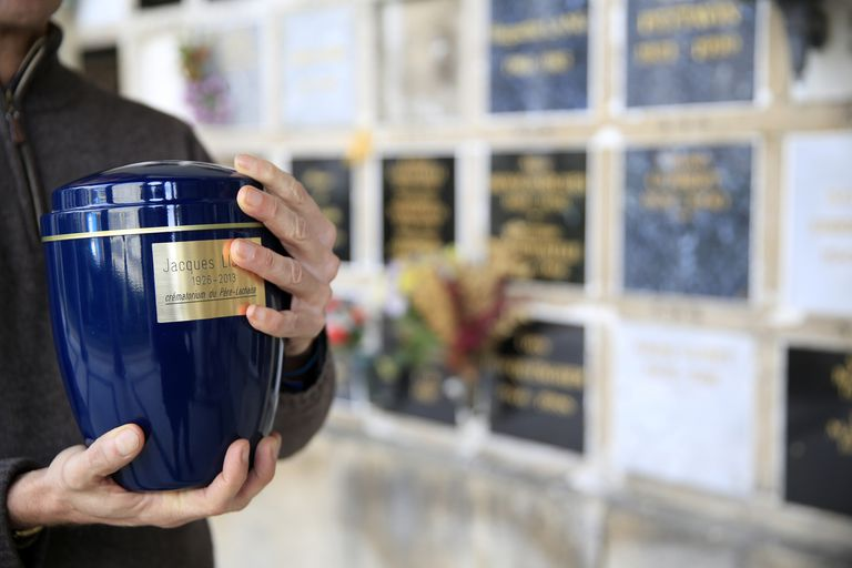 man holding urn