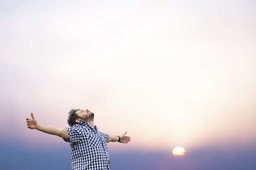 Young man with face raised toward heaven