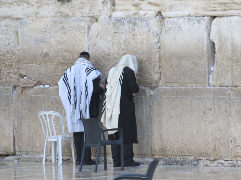 Rear View Of Men Standing At Wailing Wall