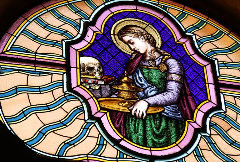 Stained glass window featuring Mary Magdalene