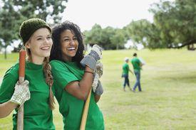 Two teenage girls doing volunteer work