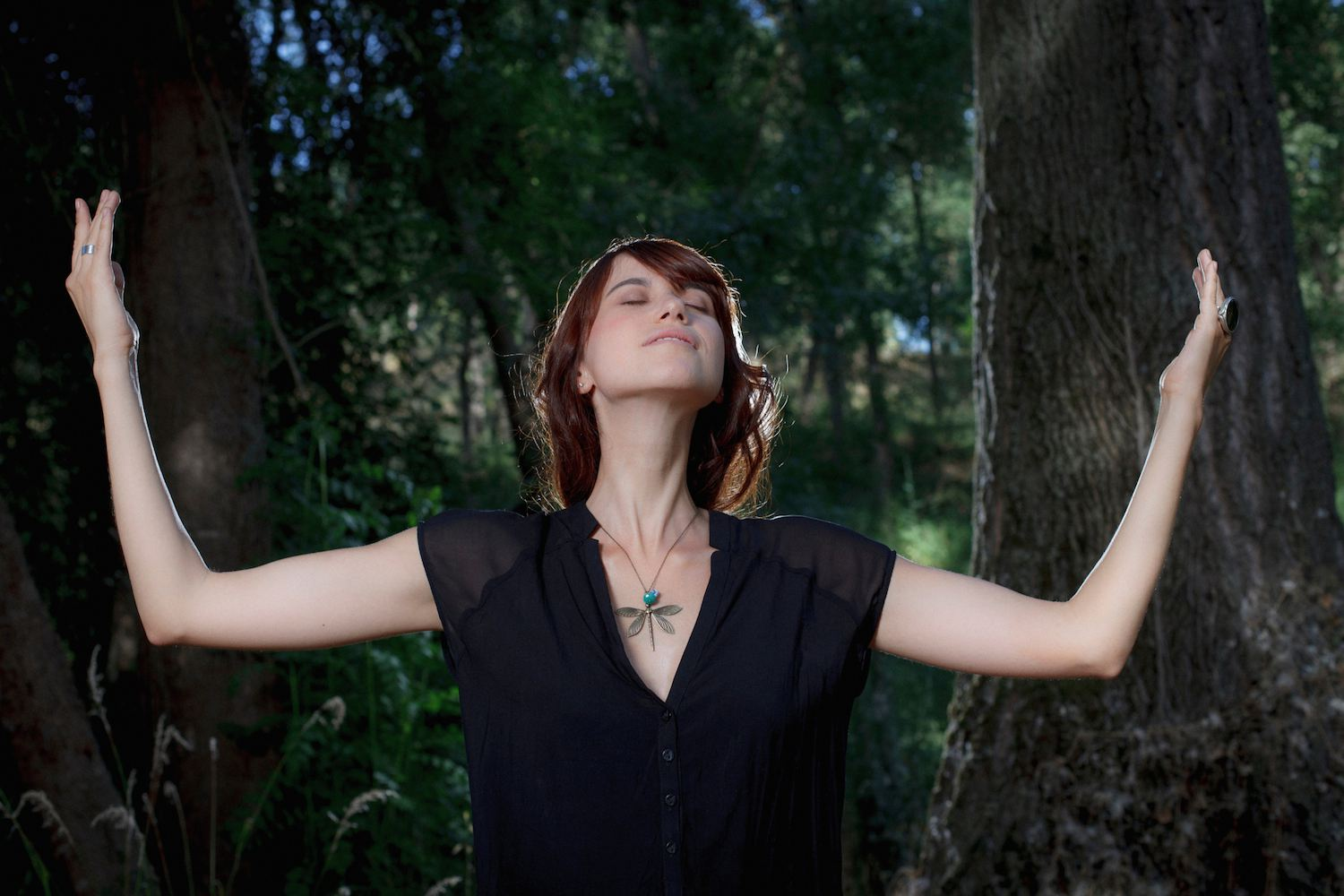 woman praying to forest