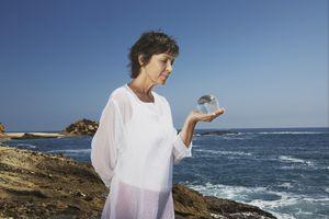 Woman holding an orb on the beach