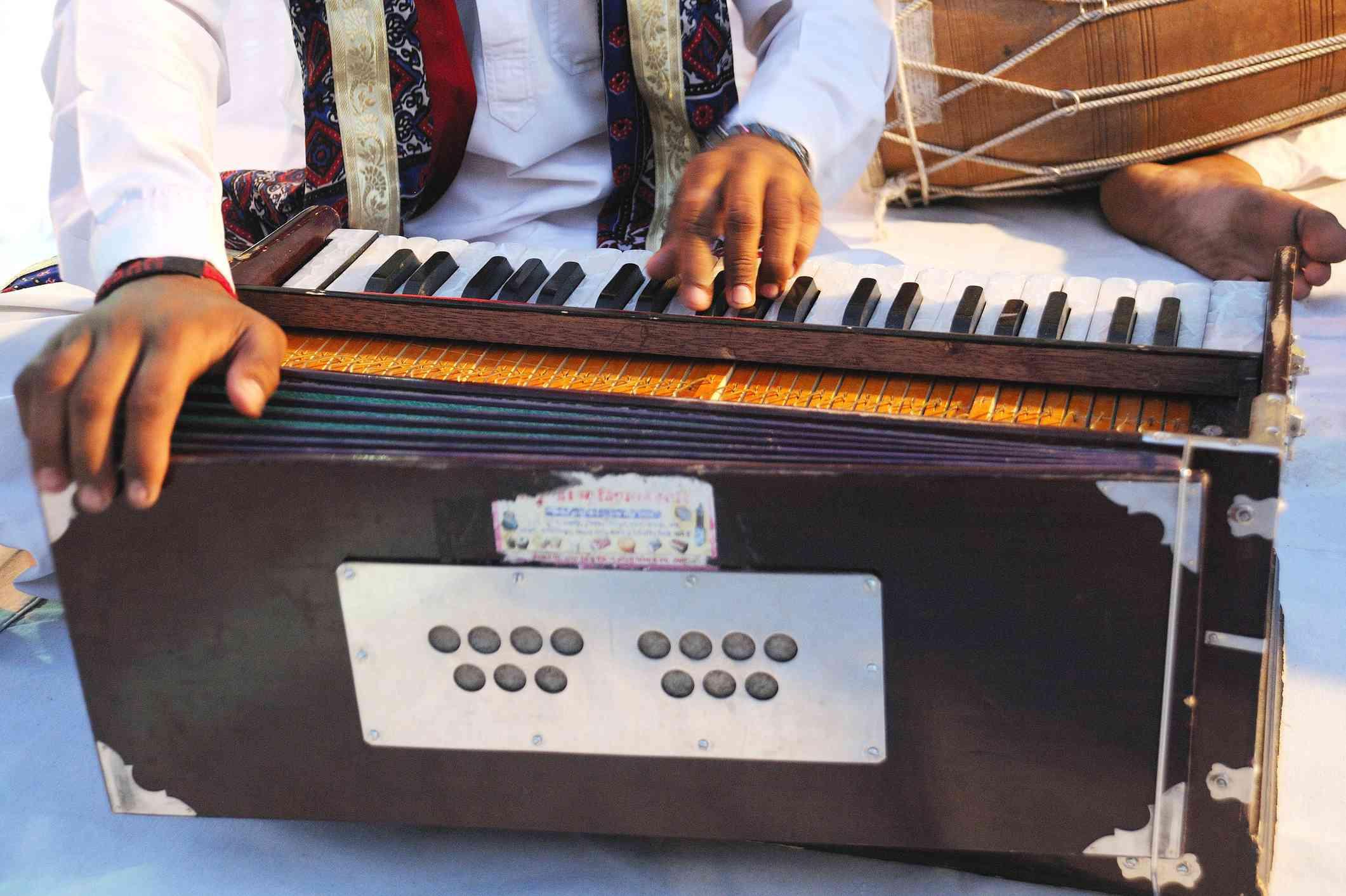 Man playing harmonium, Rajasthan, India