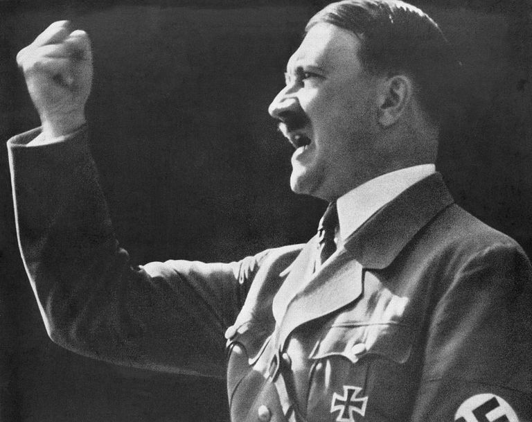 Hitler raising his fist during a speech