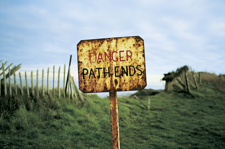 Sign that reads Danger Path Ends