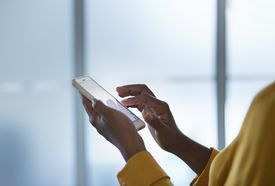 Close-up of businesswomans hands holding phone