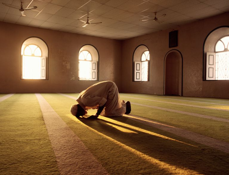 Muslim man praying in mosque.