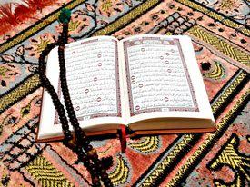 High angle view of prayer beads on a Koran