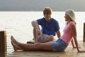 Couple seated on dock