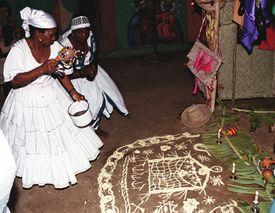 Haitian mambos performing ritual