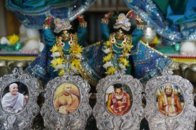 Framed portraits of spiritual leaders in the Sarcelles ISKCON temple.