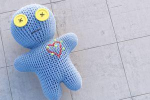 Pins sticking in voodoo doll, 3d rendering