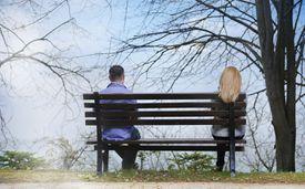 Sad Couple Sitting Apart