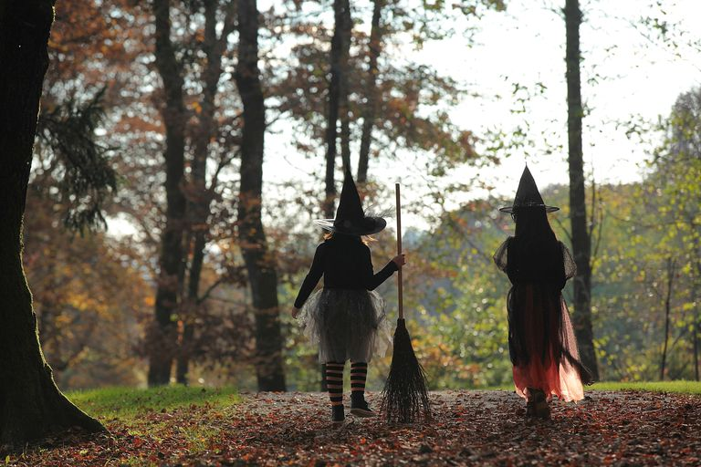 Young witches holding broom
