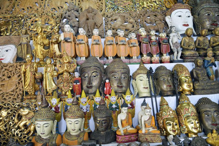 Rows of Buddhas statues and heads at display