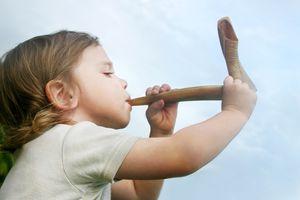 Child blowing shofar
