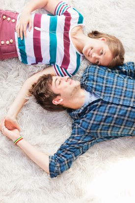 Young Couple Laying in Yin Yang Position