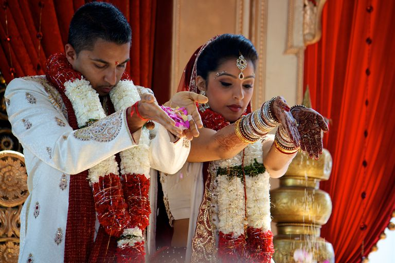 Couple performing Hindu Wedding blessings