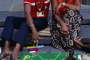 Hoodoo Practitioners of New Orleans sitting with their runes.