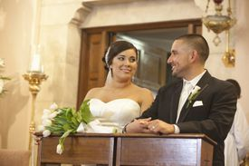 Bride and groom in Catholic wedding.