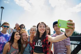 A girl taking a selfie with her friends
