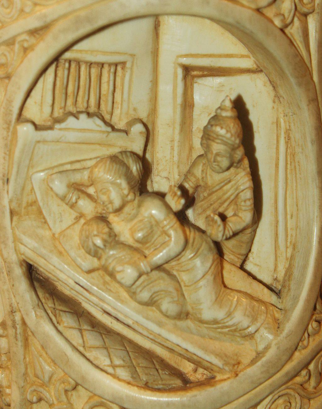 Ivory carving of Buddha leaving a woman and child sleeping in bed.
