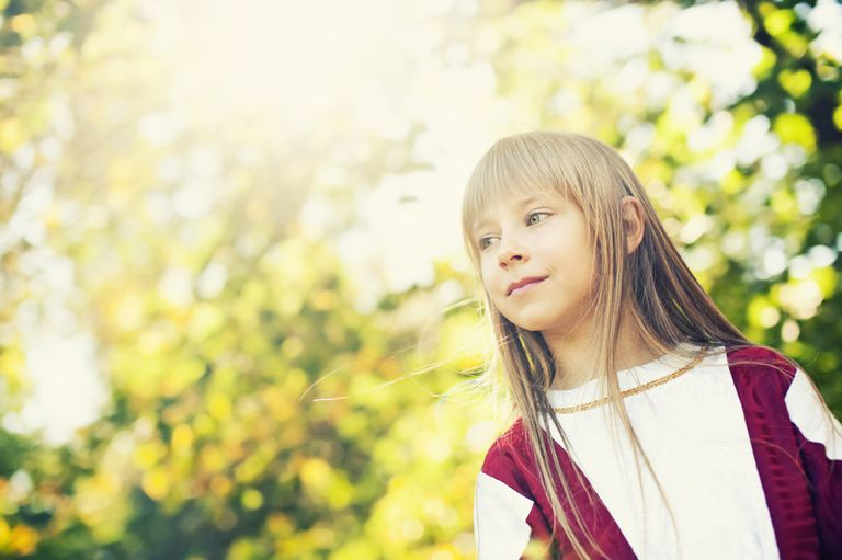 Child Outdoors in Sunny Forest