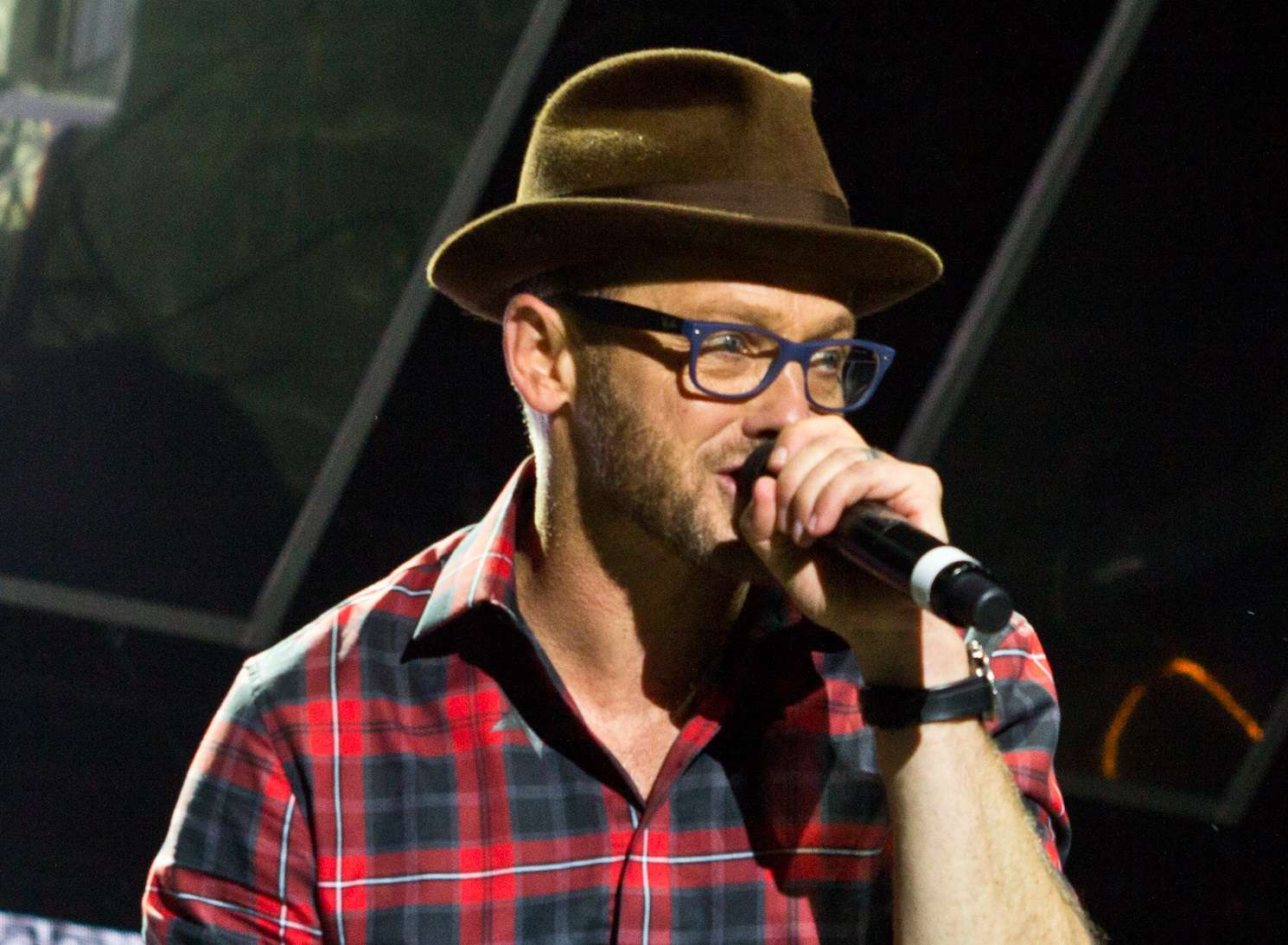 TobyMac performs live onstage.