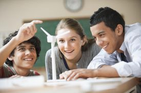 Teenage students studying wind power