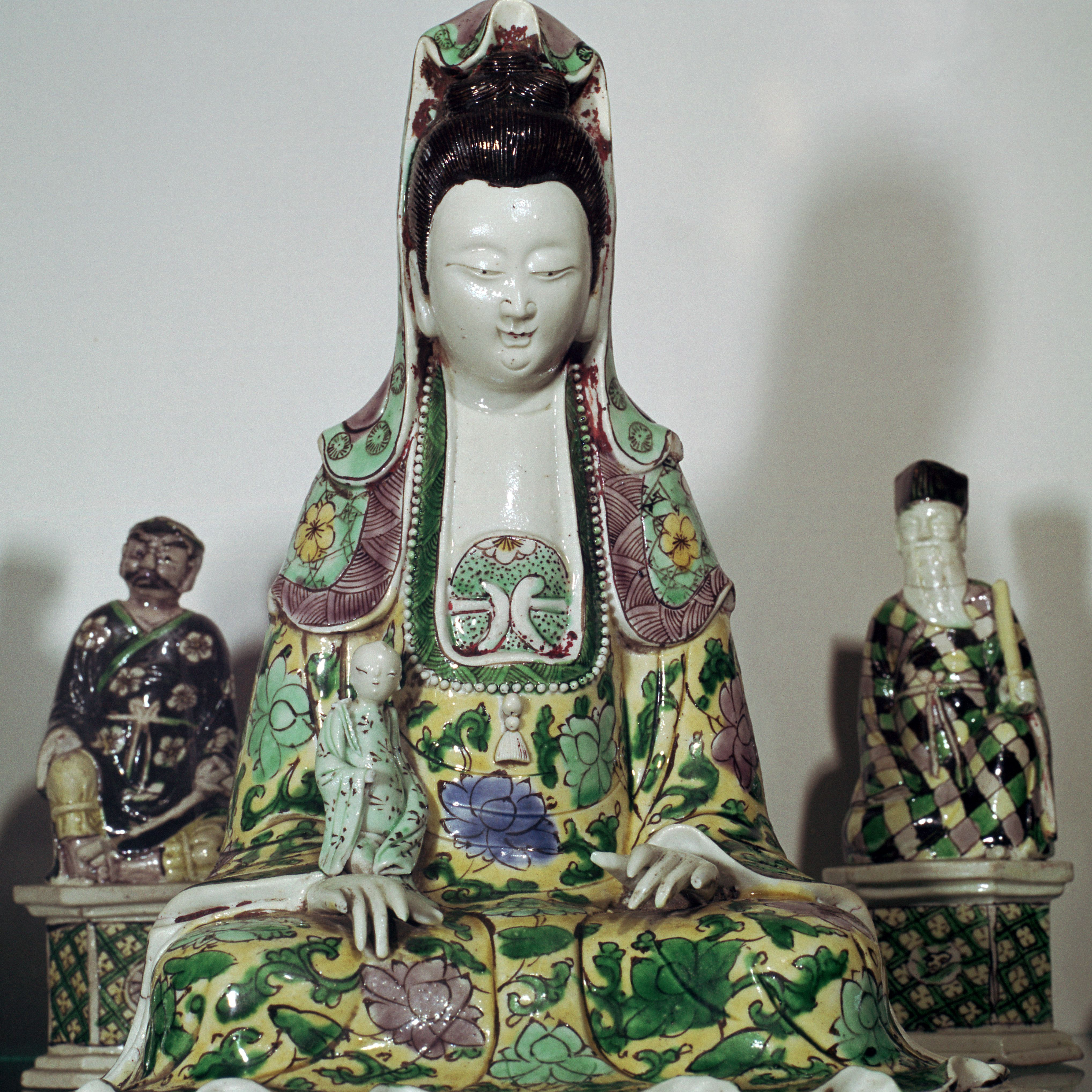 statuette of Kuan-Yin, the Taoist goddess of mercy.